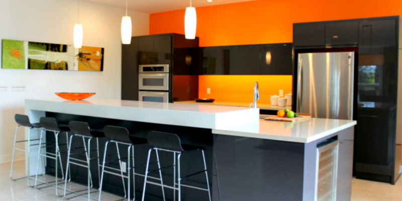 The bright orange gives this kitchen a pop of color
